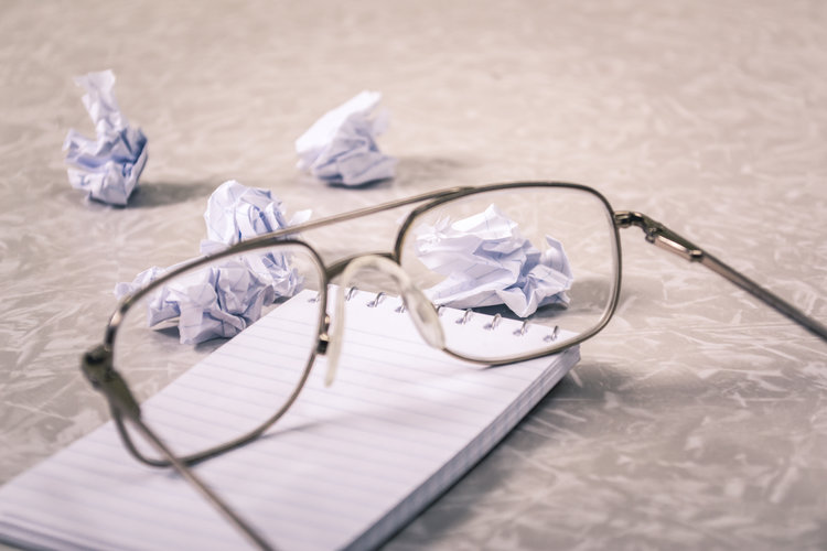 glasses on pad of paper